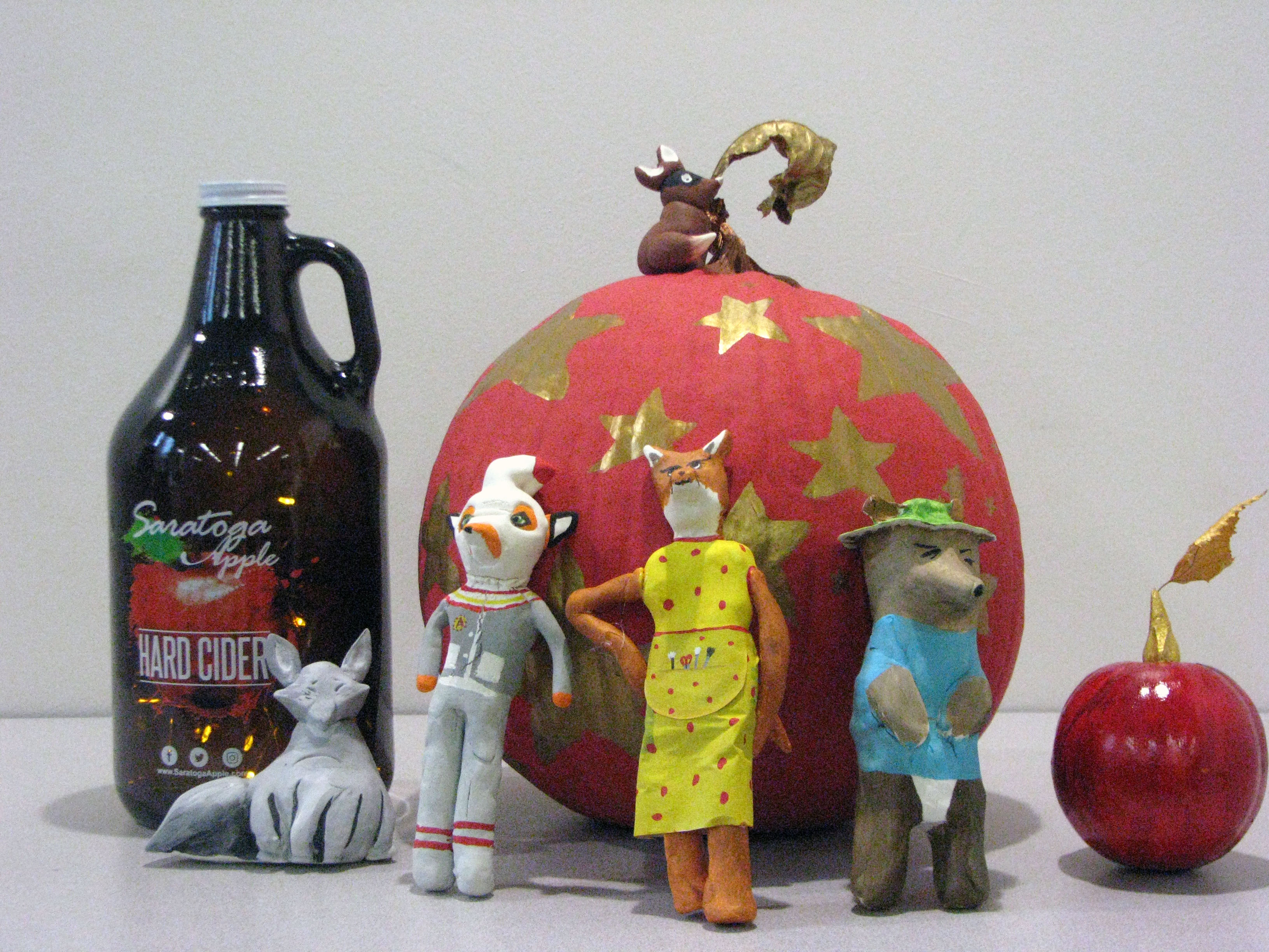 Painted pumpkin with clay, animal figures