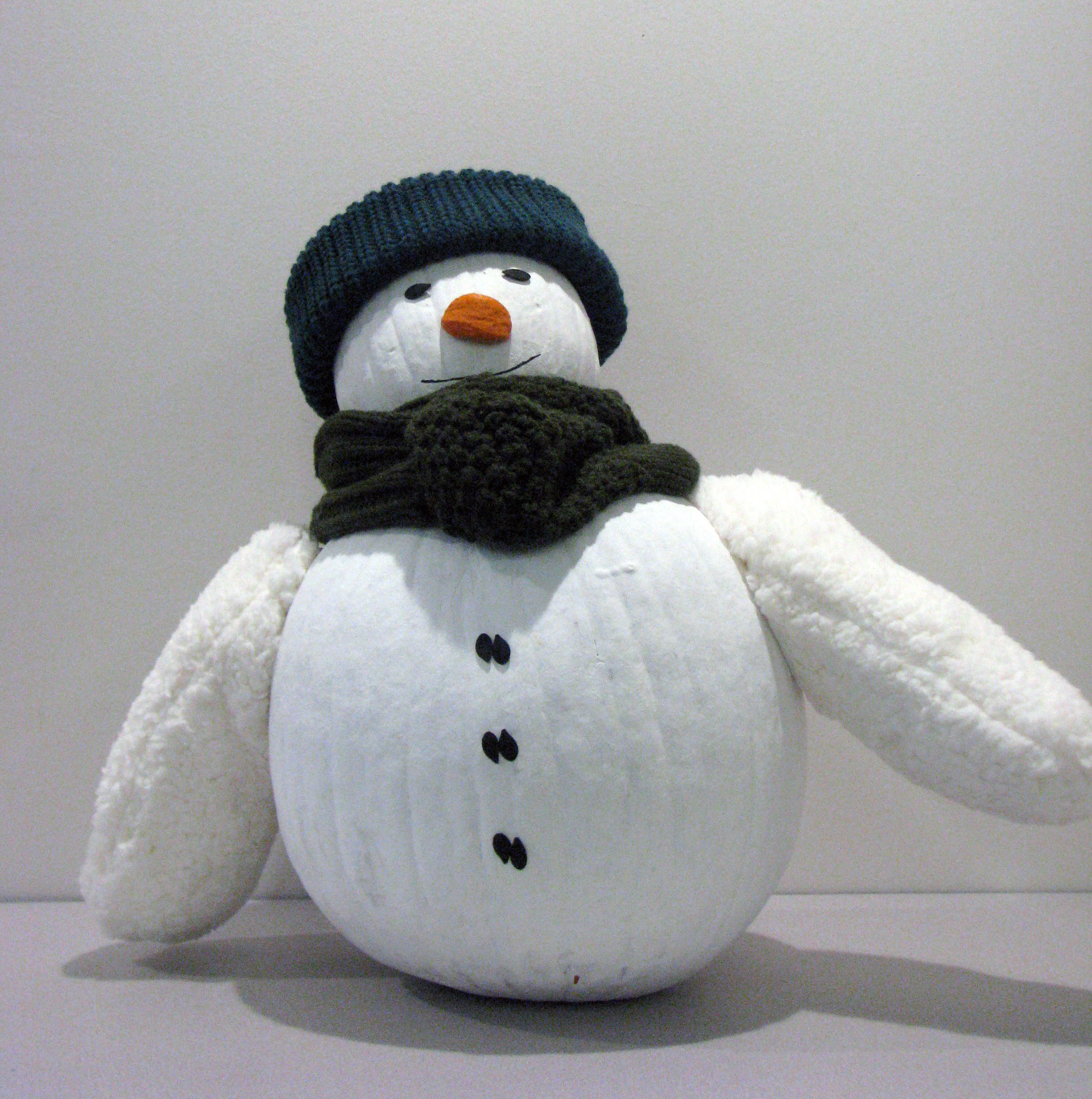 Painted and knitted pumpkin of a snowman