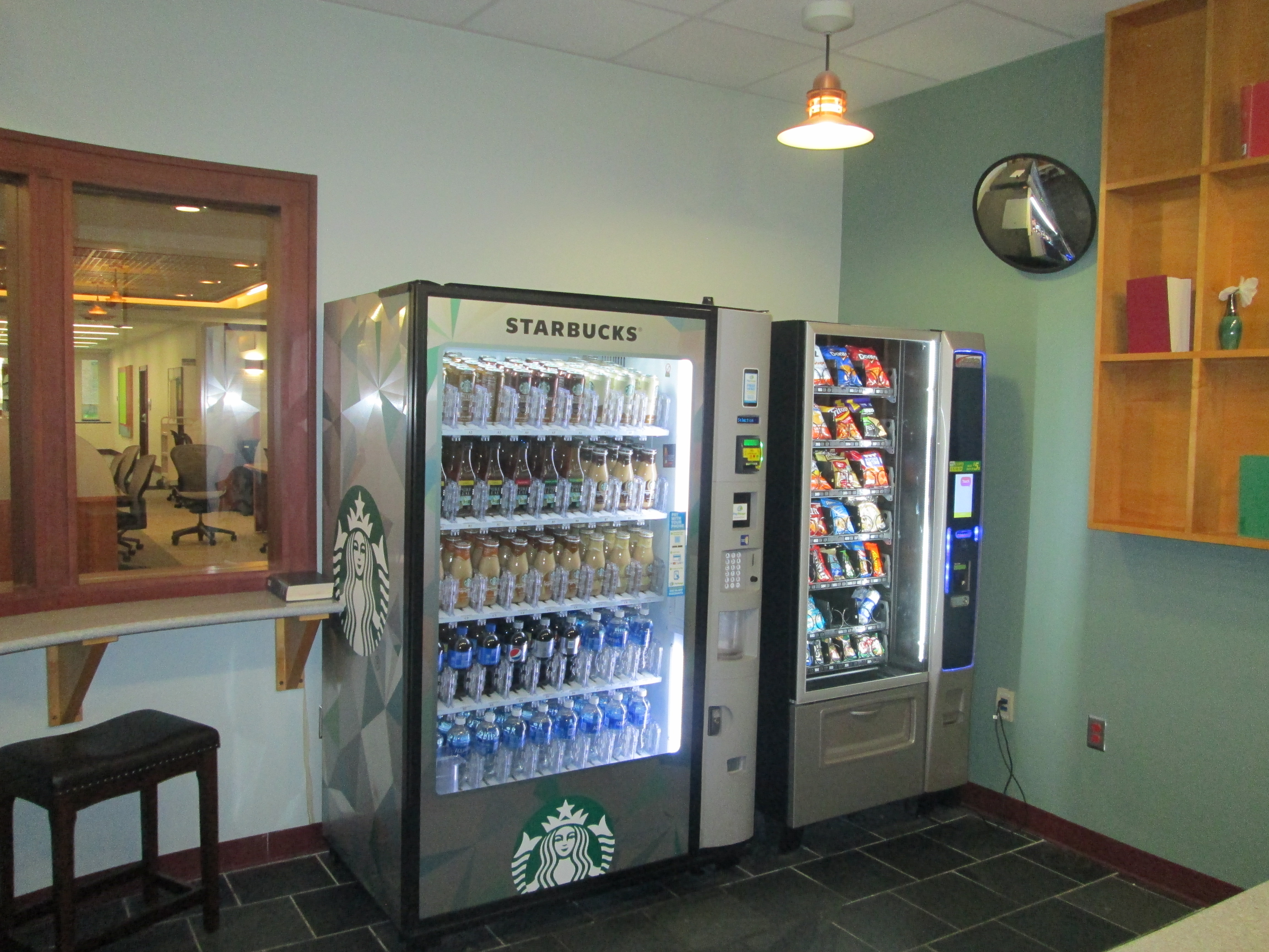 Cold vending machines with drinks and snacks