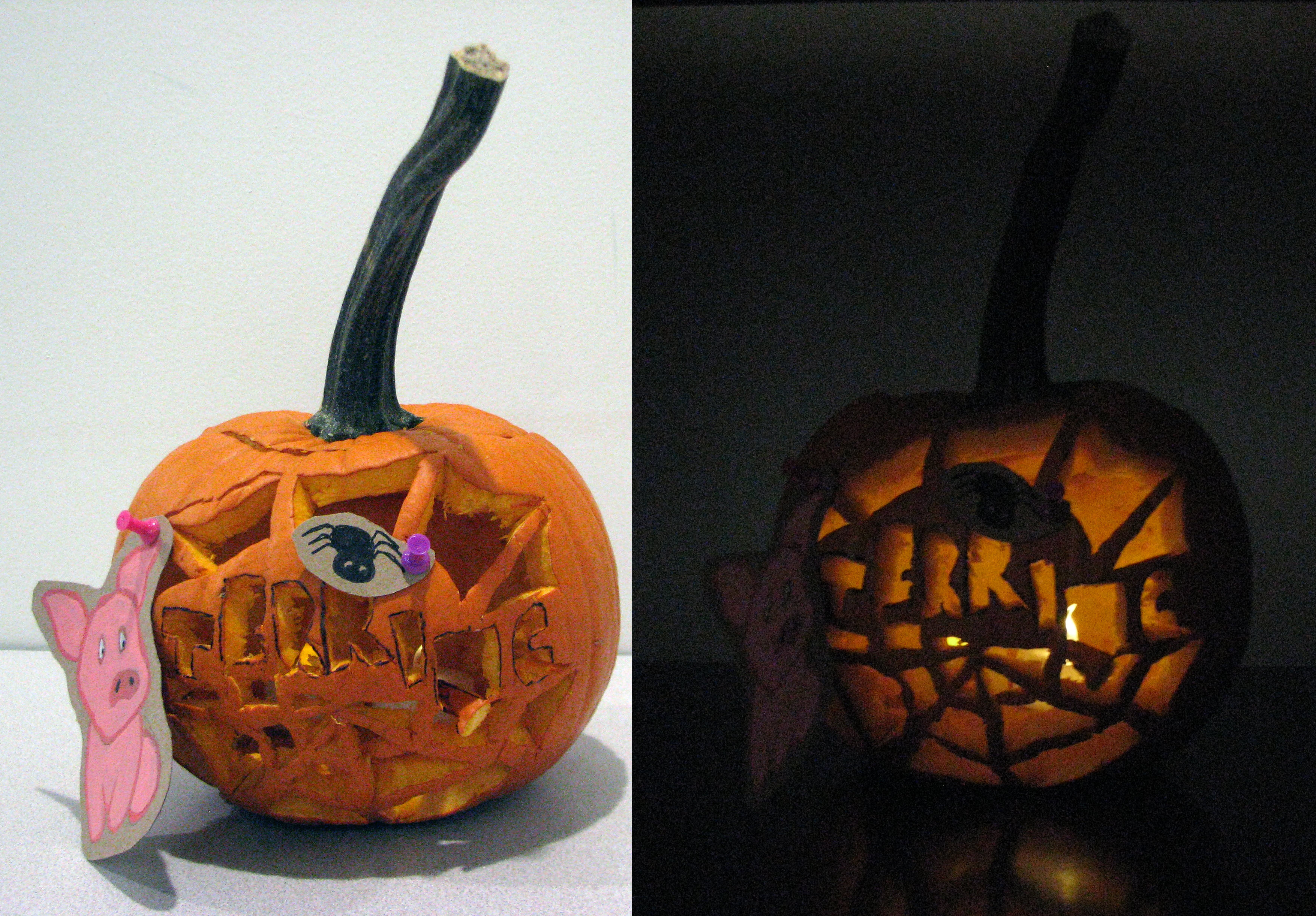 Carved pumpkin with attached paper cutouts