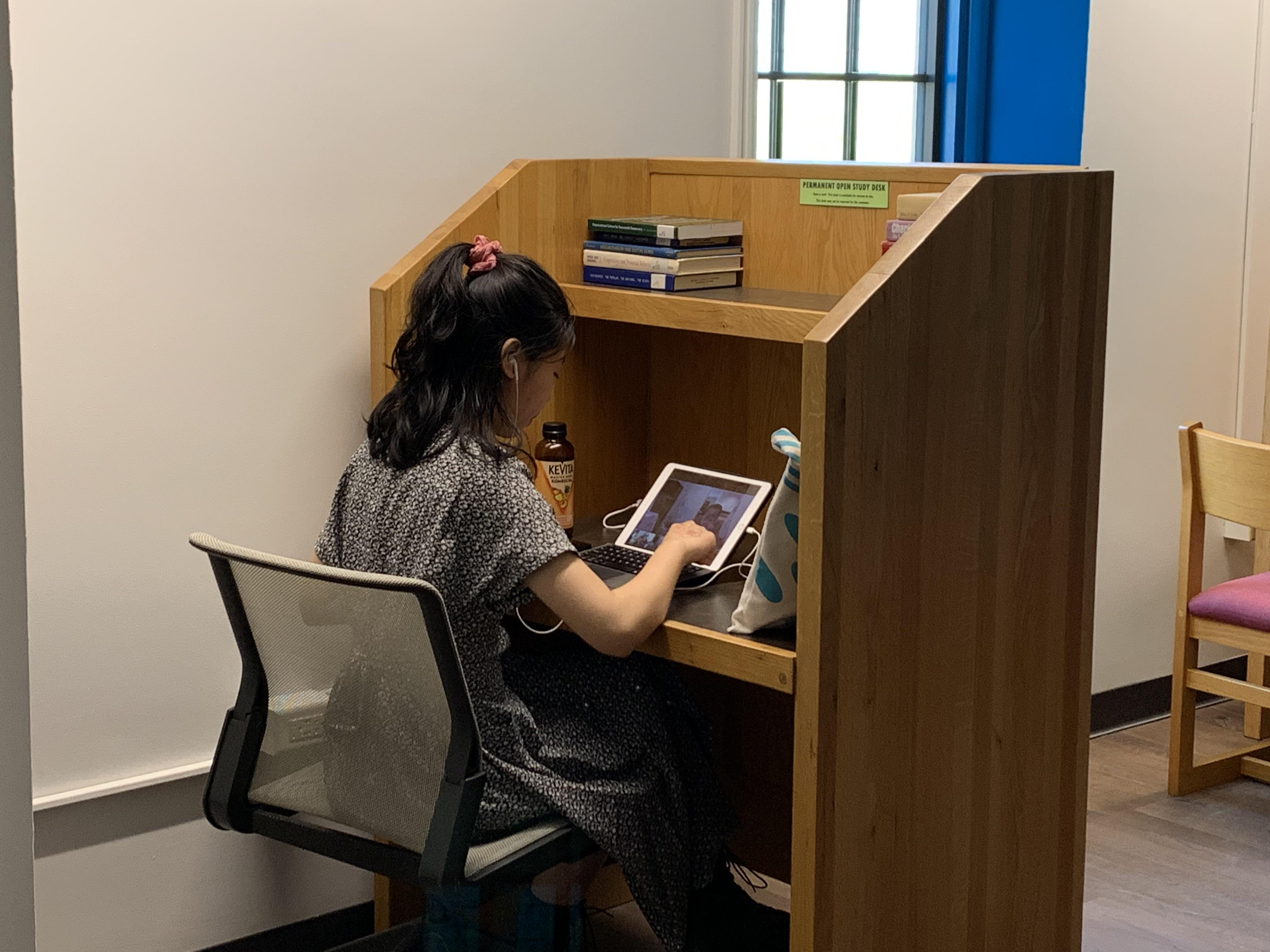 Student studying at individual carrel