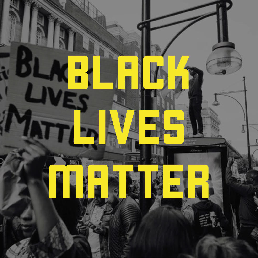 Black and white photo of protesters holding up a Black Lives Matter sign