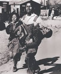 Black South African protestors carrying an injured child (Time, Inc.)
