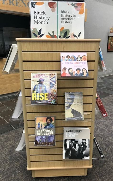 Library stand book display. Sign on top reds, Black History Month; Black History is American History