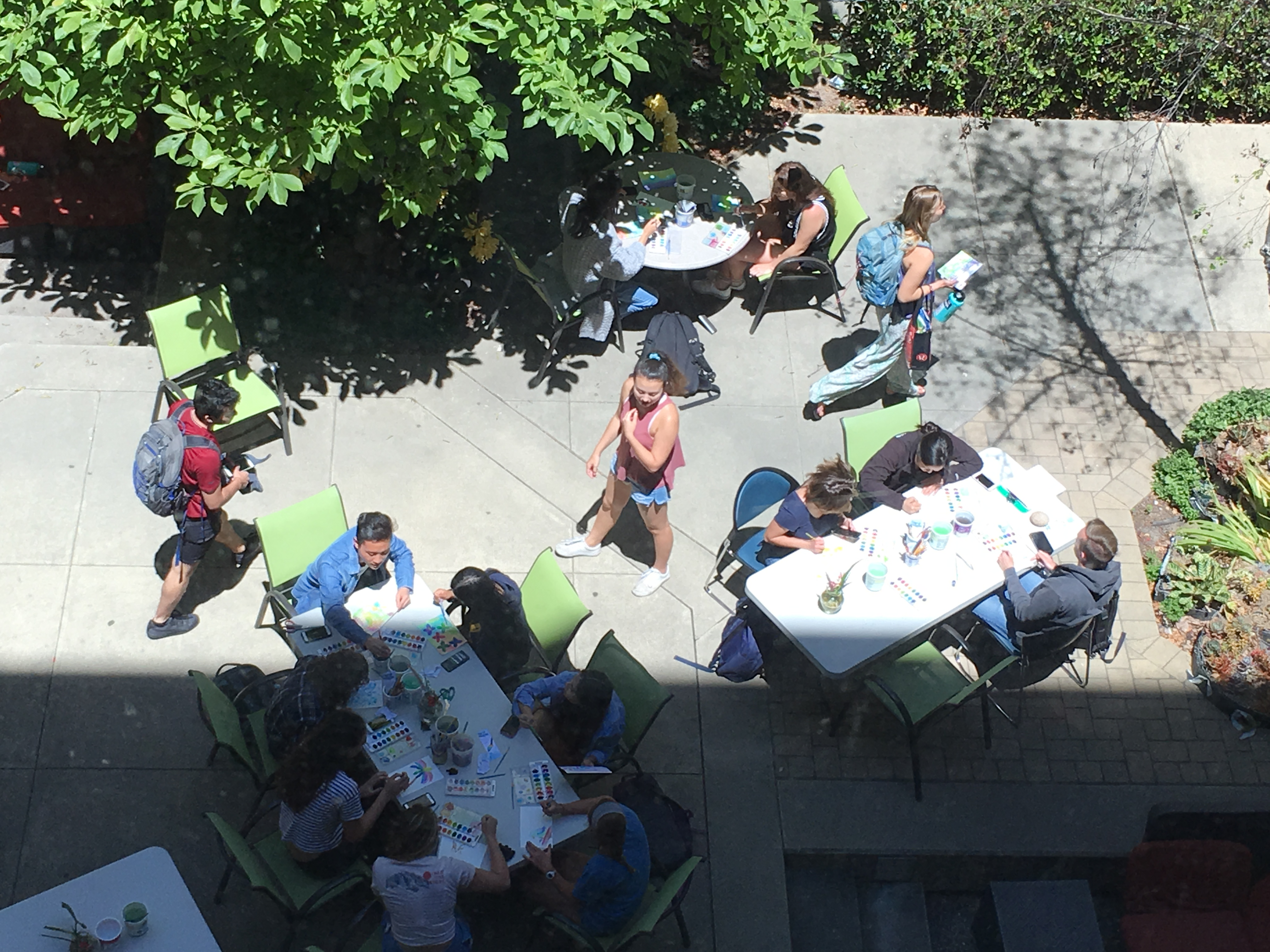 students watercoloring in the Kennedy Library atrium on a sunny spring day