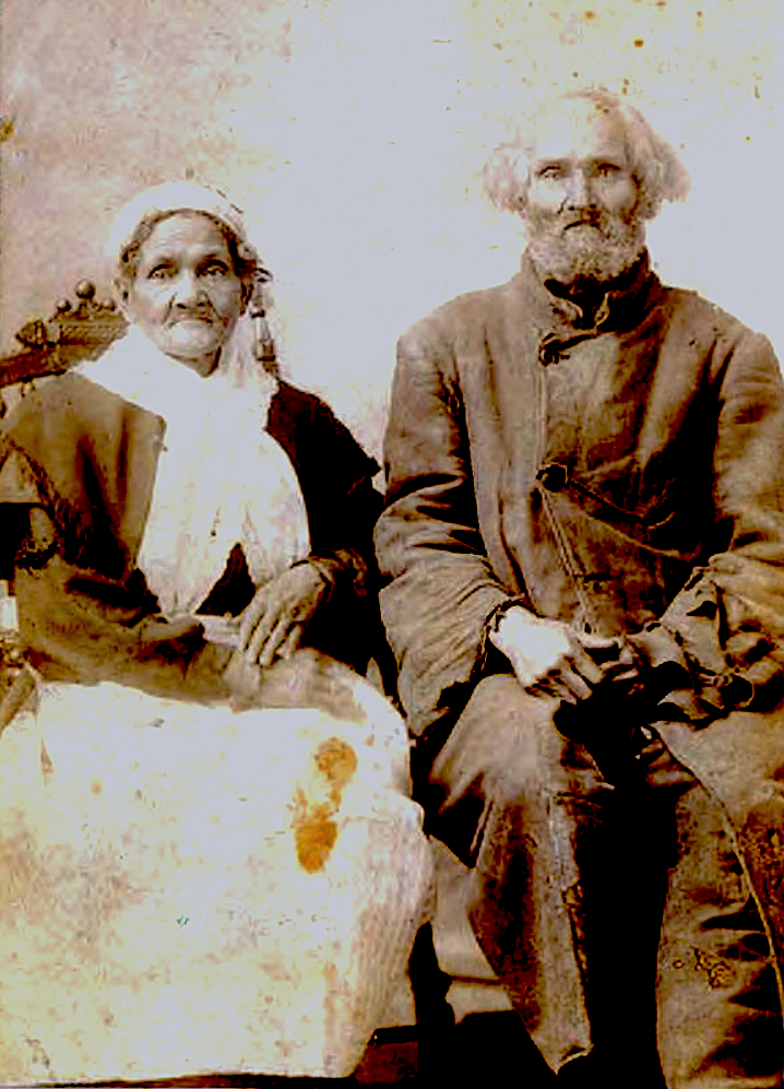 black and white portrait of hannah (left) and aaron jackson posing on chairs for the camera.