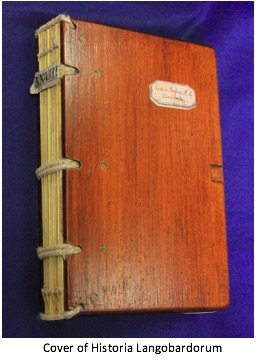 photograph of the cover and binding of the Historia Langobardorum which features a wooden cover and exposed binding.
