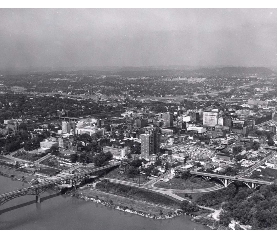 aerial view of the south side of the Tennessee River. Visible structures include Gay Street Bridge, Andrew Johnson Hotel, and Hamilton Bank Building.
