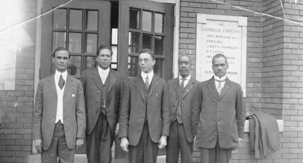 photograph of african american leaders in knoxville tennessee in 1920 standing in front of Knoxville's Carnegie Library.