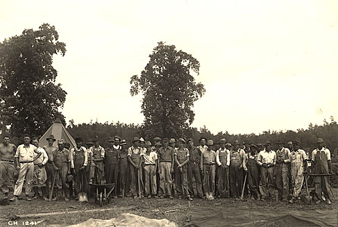 black and white photograph of a group of TVA employees standing together in the outdoors.