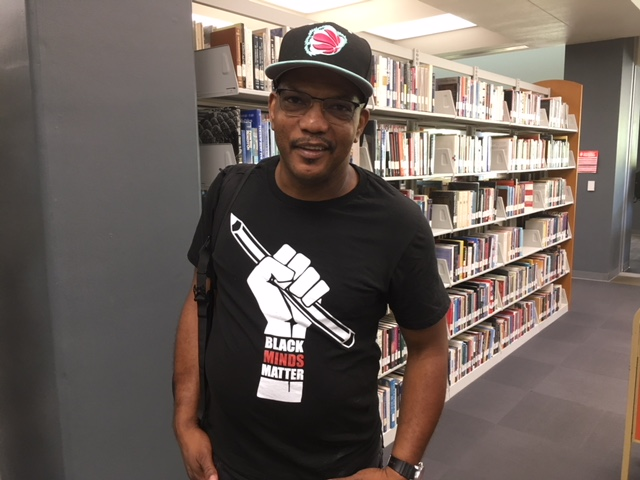 ARC student Ray in the ARC Library wearing a black minds matter t-shirt