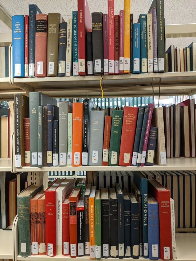 Books about Romanesque and Gothic architecture on the shelves at Simpson Library