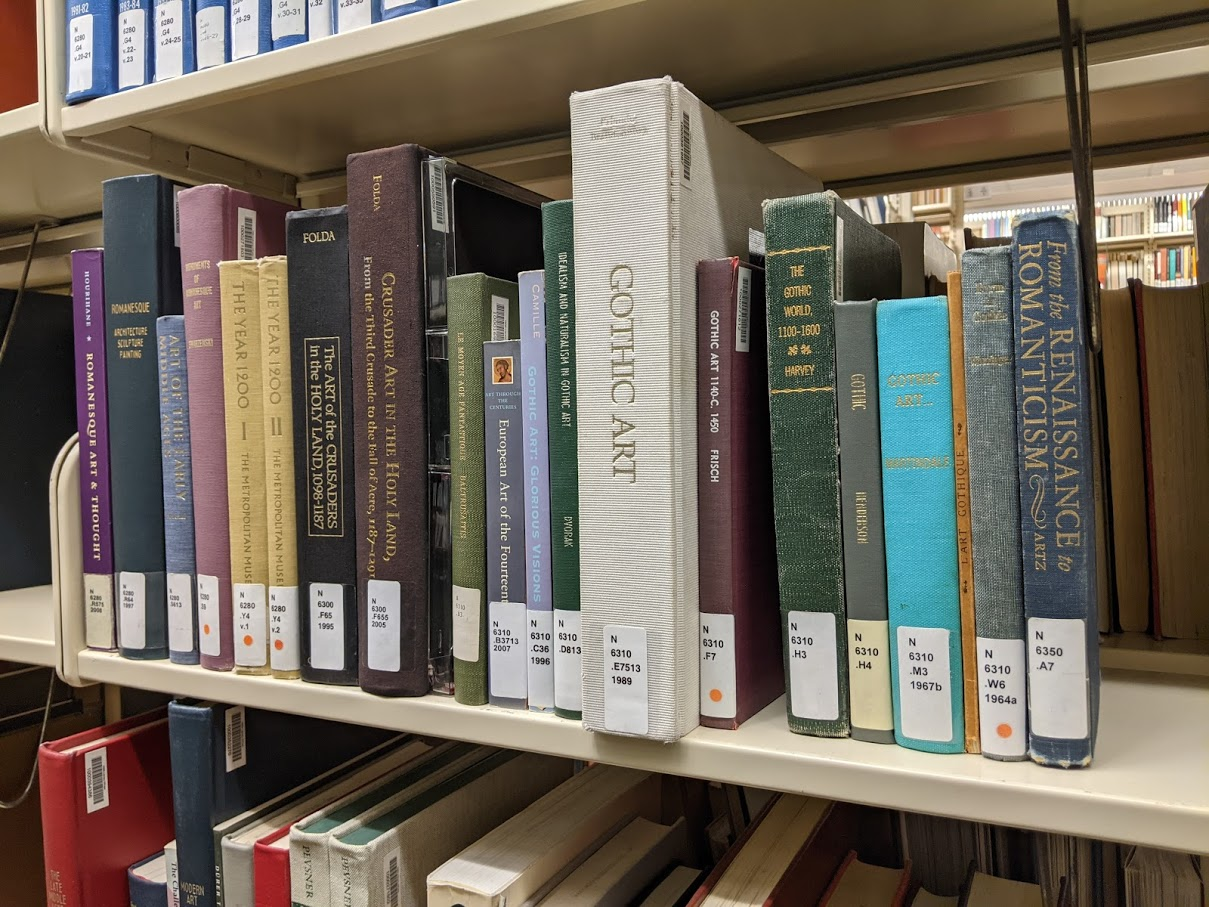 Books about Romanesque and Gothic art on the shelves in Simpson Library