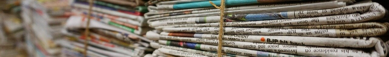 A photo of a pile of newspapers tied up with twine