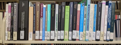 A photo of a shelf of books about endangered languages, in Simpson Library