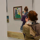 Photo of women taking cell phone photos of art in a museum