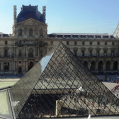 Photo of glass pyramid in front of Louvre