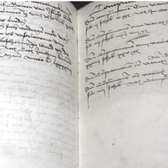 Photograph of handwritten book pages