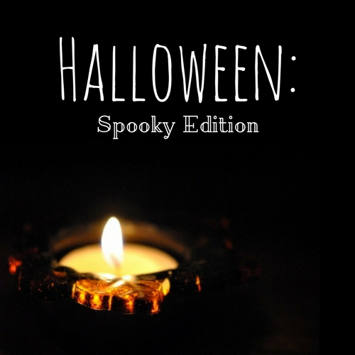 Halloween: Spooky Edition playlist cover - mostly dark with a lit candle in the bottom left corner