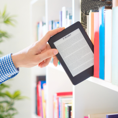 E-reader being pulled off a bookshelf as if it were a print book