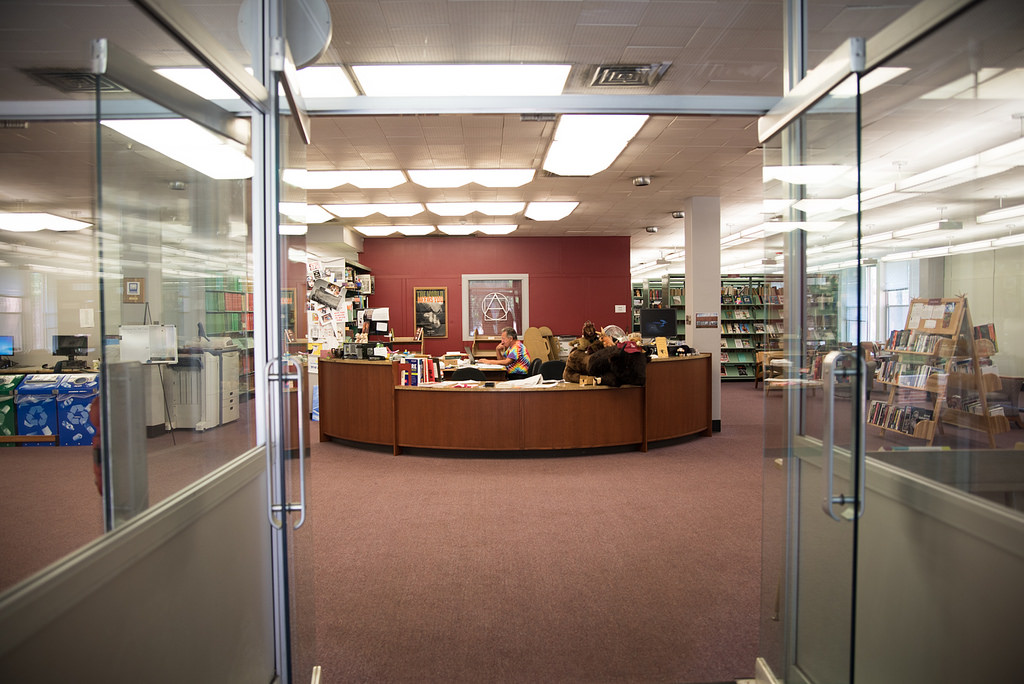 The front entrance of the library with the circulation desk about 10 steps away.