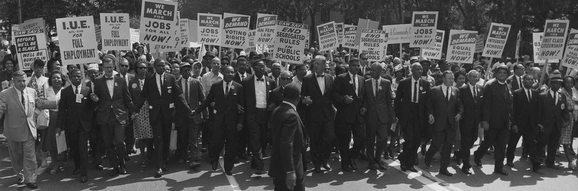 Civil rights marchers carrying signs in Wahington, DC, 1963