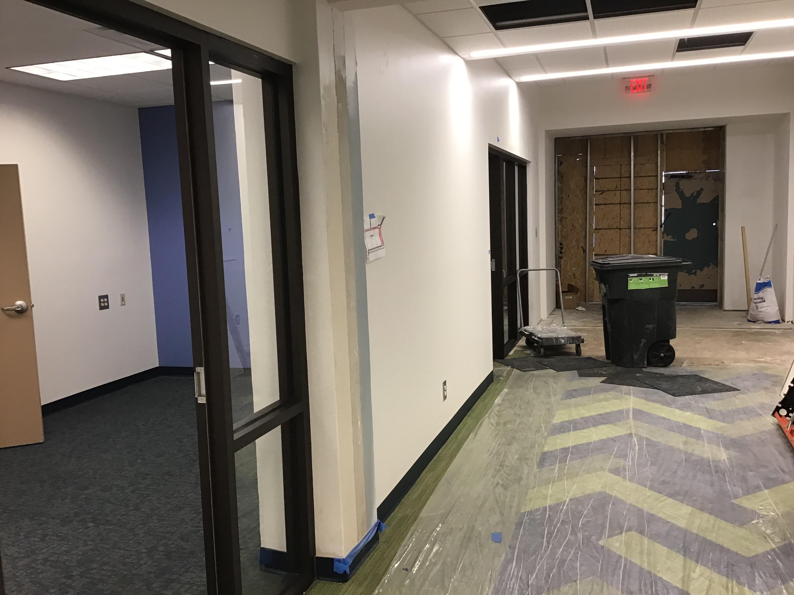 The dean's office, left, is near the entrance to the new addition to the building.