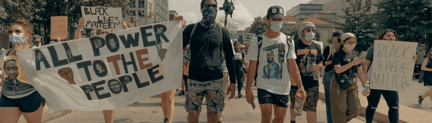Stock photo of protesters marching in 2020