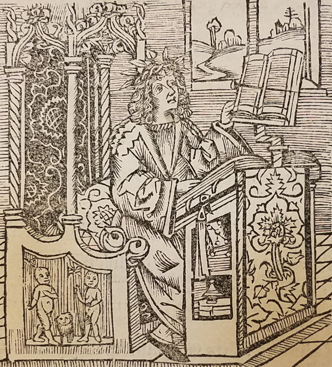 Horace sitting at a desk
