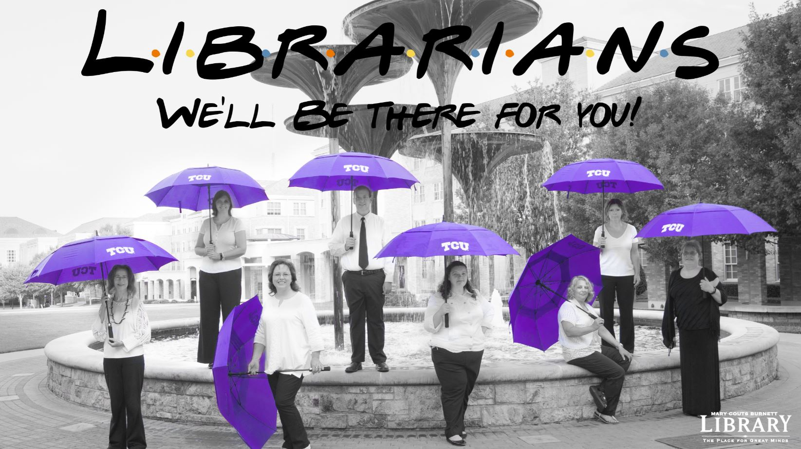 Librarians in front of Frog Fountain with Umbrellas