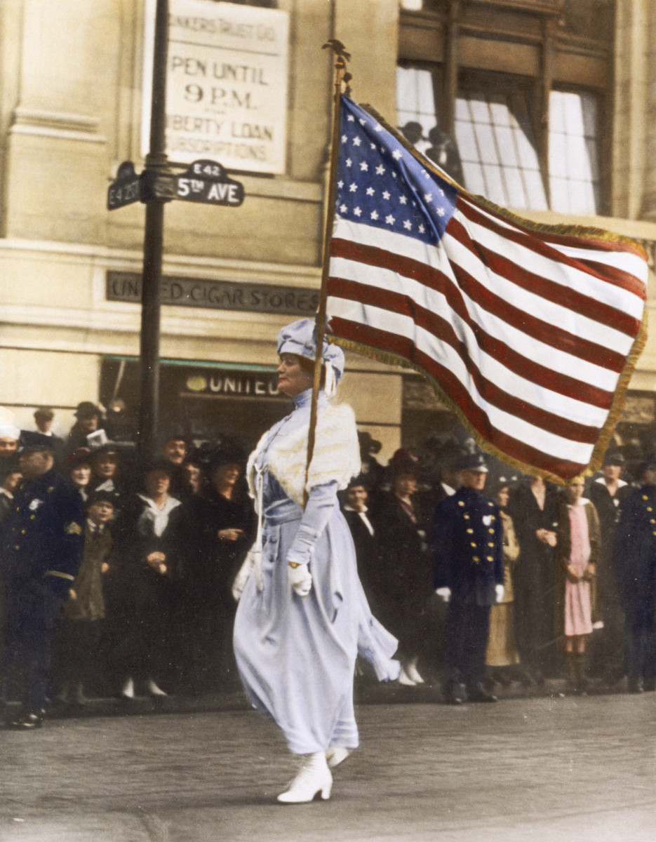 woman marching in suffrage parade