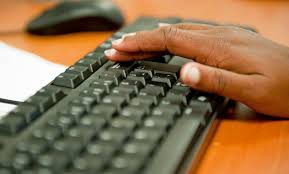Image of hand on keyboard