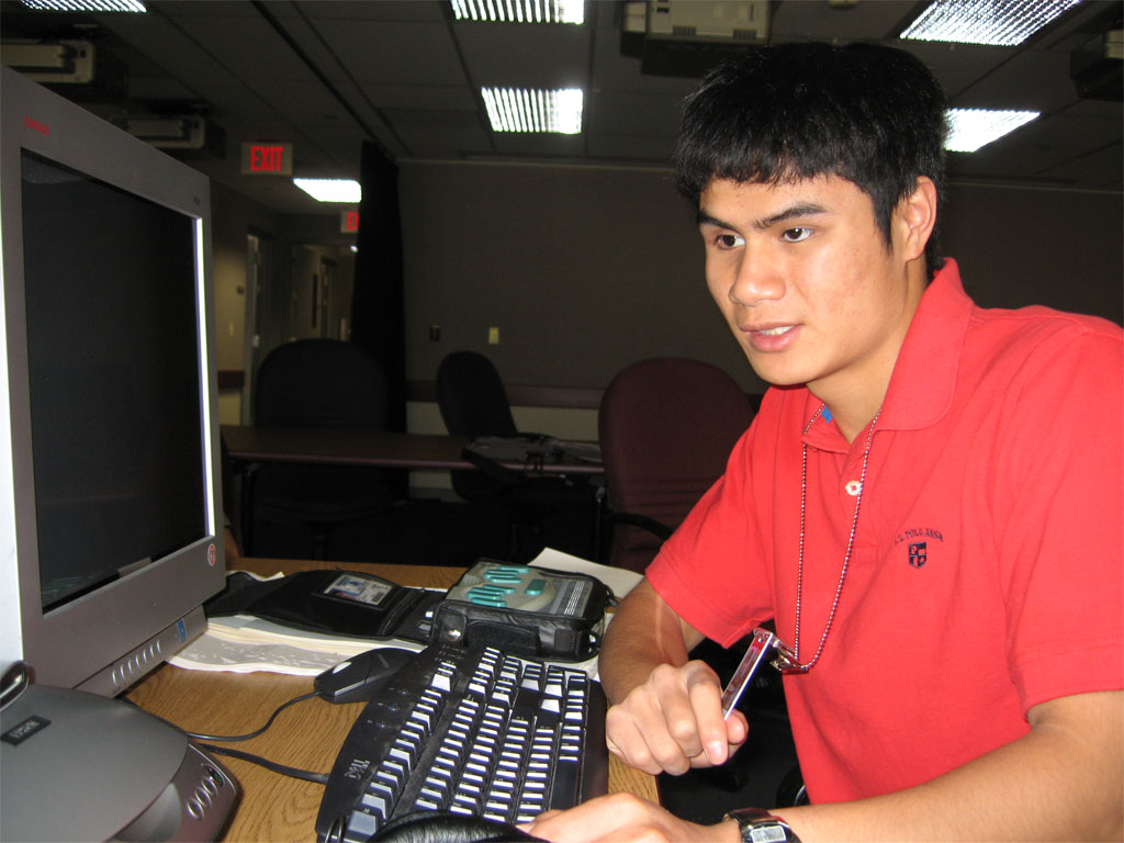 Image of young man at computer