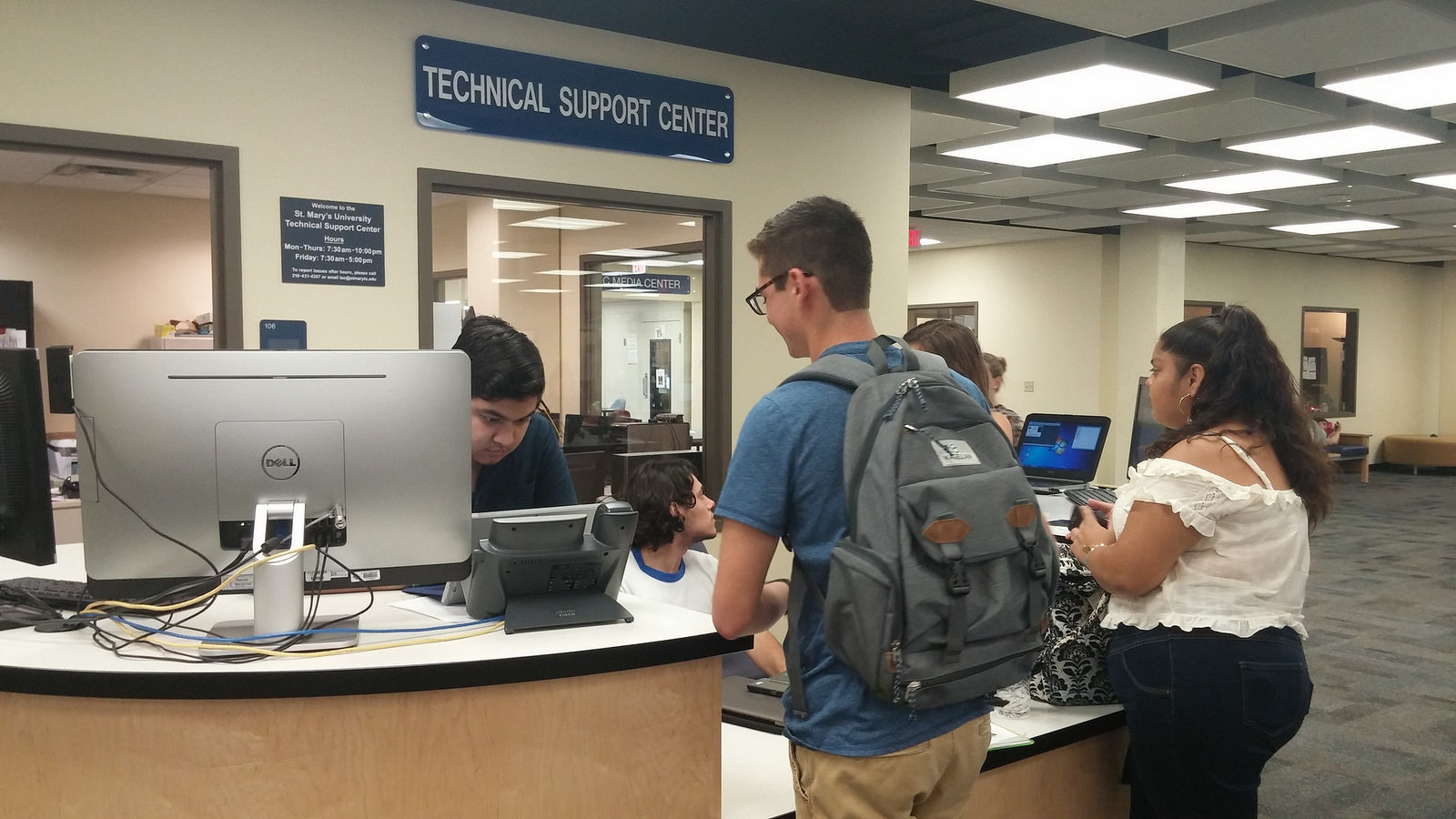 photograph of students at the Technical Support Desk
