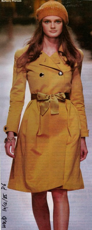 Runway image of yellow winter coat from Burberry