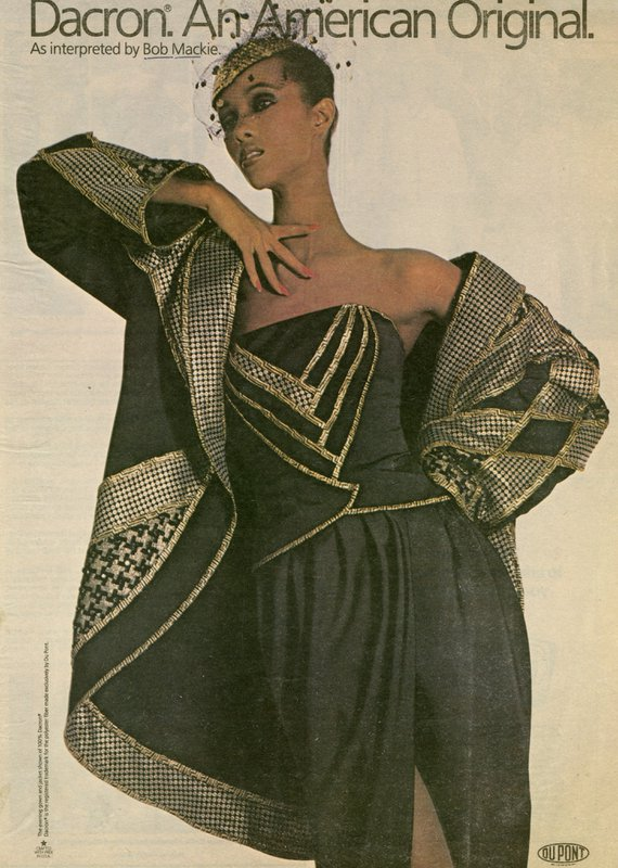 Advertisement with model in green and gold eveningwear