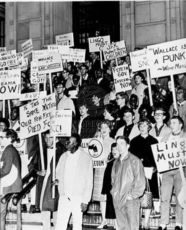 PROTESTERS FROM FRIENDS OF STUDENT NON-VIOLENT CO-ORDINATING COMMITTEE STAND ON STEPS OF FEDERAL COURTHOUSE. [Graphic], 09/17/1963