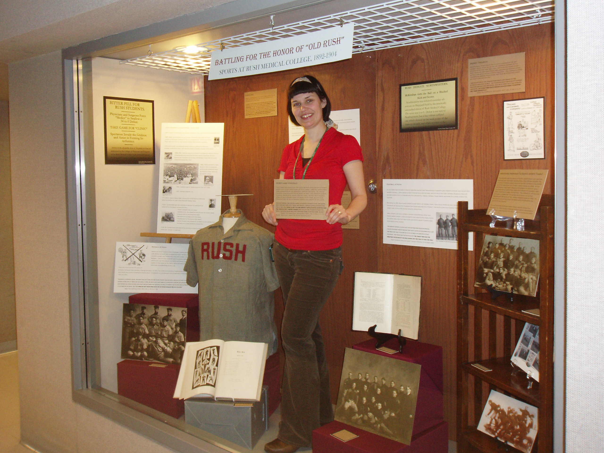 Archivist Nathalie Wheaton in archives display case, 2007