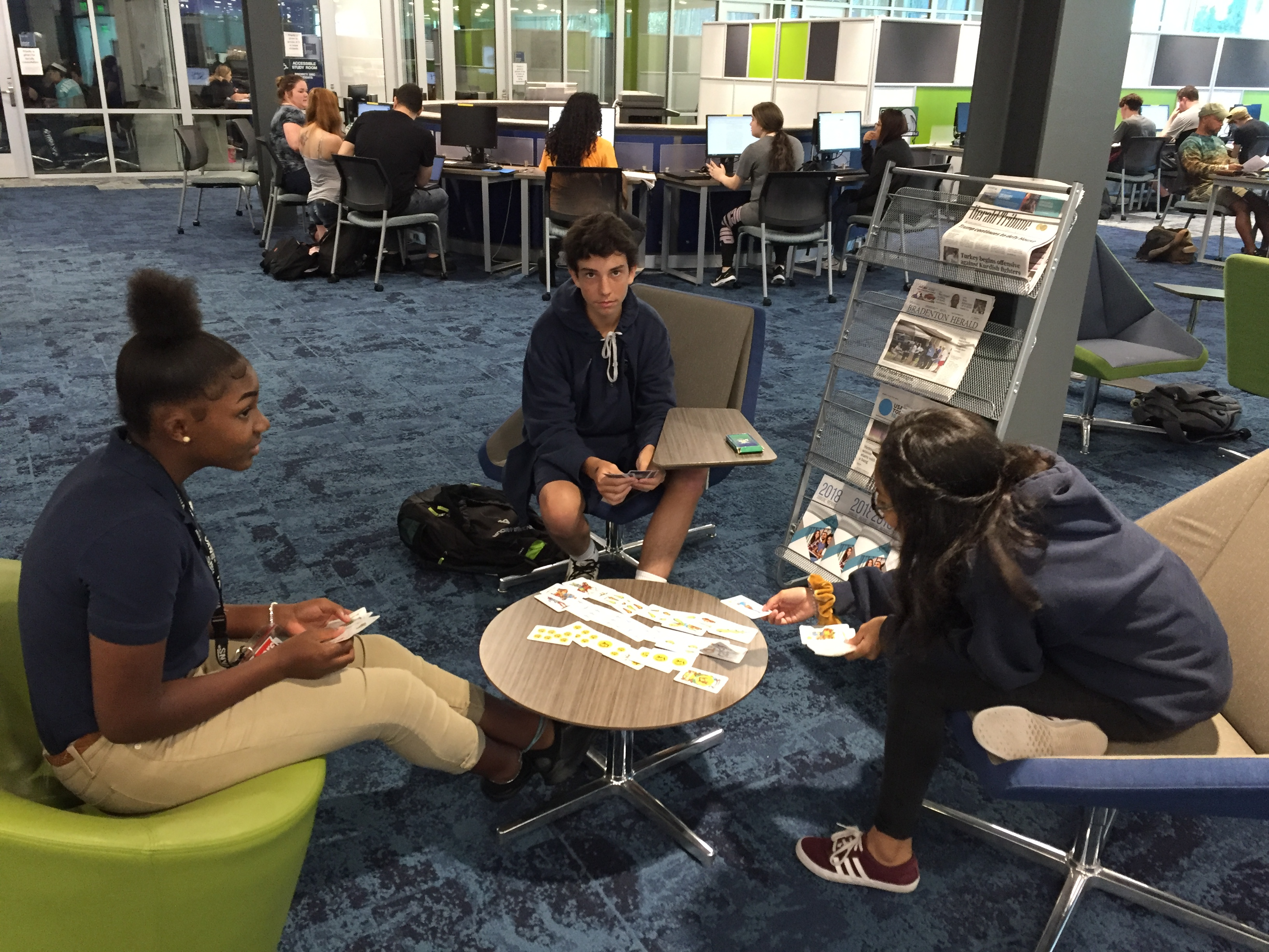 Students playing Spanish card game