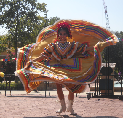 Dancer Spinning at Carnval. From Multicultural Center archive in Special Collection