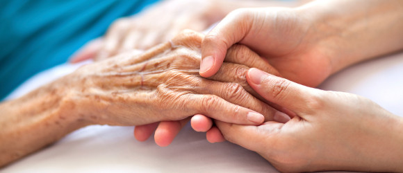 Hand holding at end of life