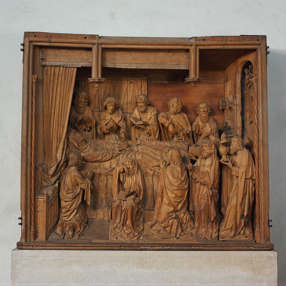This high-relief sculpture, once painted, was the central scene of an altarpiece, the wings of which depicted the Birth of the Virgin and the Nativity.