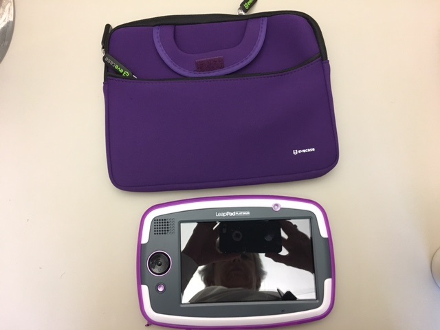 Picture of a LeapPad and a LeapPad holder