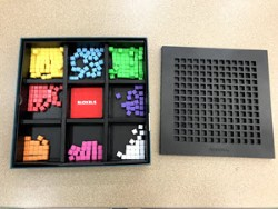 What the Bloxels kit comes with: yellow, blue, green, red, purple, orange, pink, and white game pieces, and a game board for you to put the pieces in