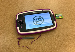 The LeapPad, pictured with a cartridge for the Bubble Guppies game
