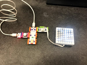 "LittleBits code pieces connected to a computer with ""CE"" displayed on the lightup screen"