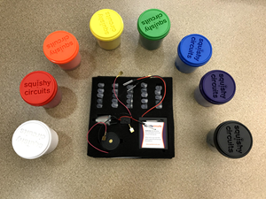 Squishy Circuits; 6 colorful conductive doughs, 2 black and white non-conductive doughs, 25 lights, battery pack, and conductive wires