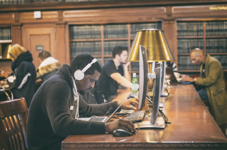 students studying at college library