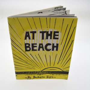 cover image of at the beach by babette katz