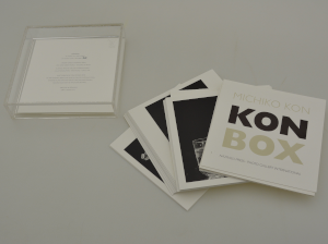 The kon box with cards spread beside it